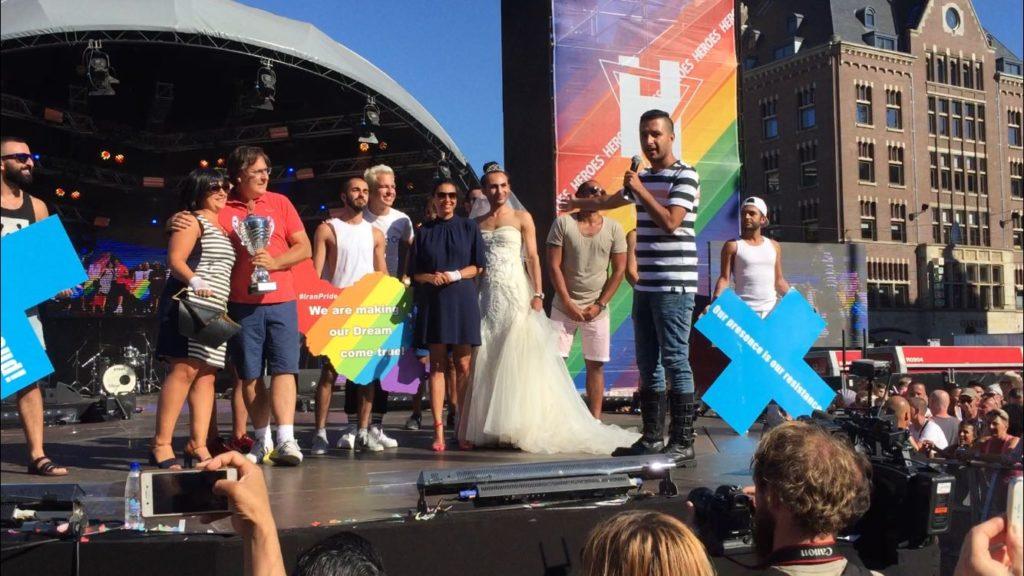 Raham Rafiee speaking at the Amsterdam Pride closing ceremony